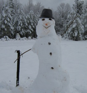 Distinguished country snowman seen strolling.